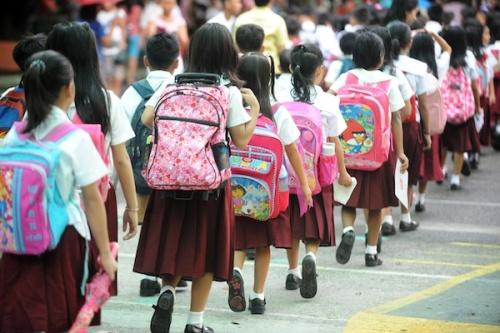 Children make their way to their class r